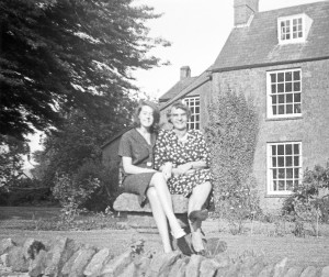 Shân Morgan with Lucy Eadon on the birdbath at The Vicarage 1963 or 64